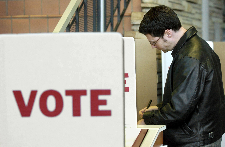 An Oklahoma voter fills out a ballot