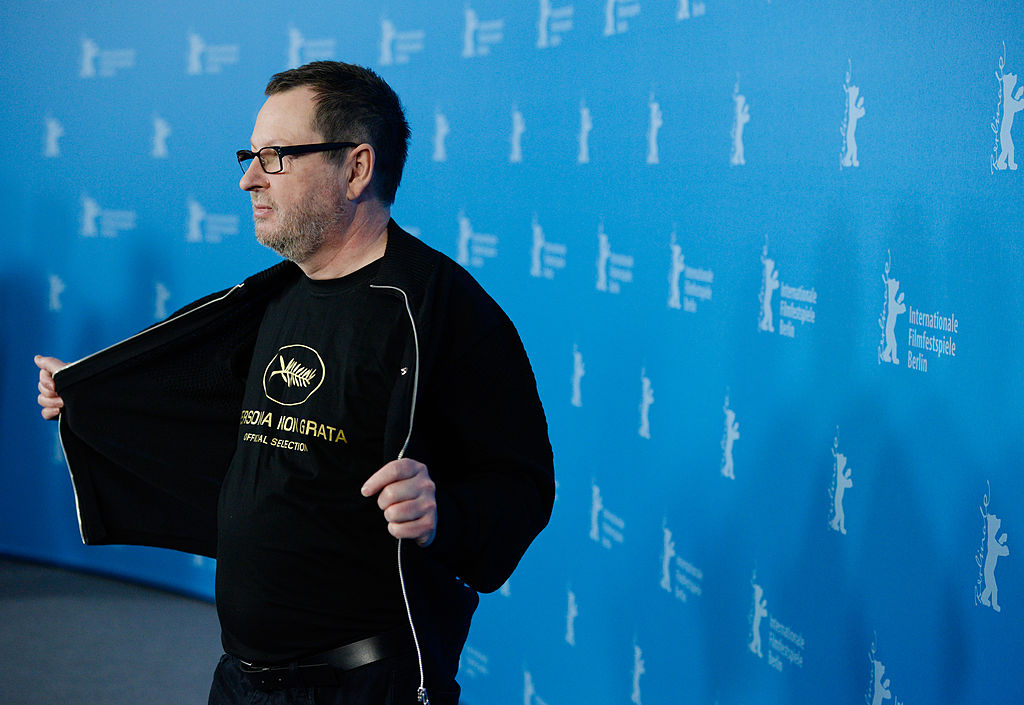 Lars Von Trief, holding his sweartshirt open on the red carpet