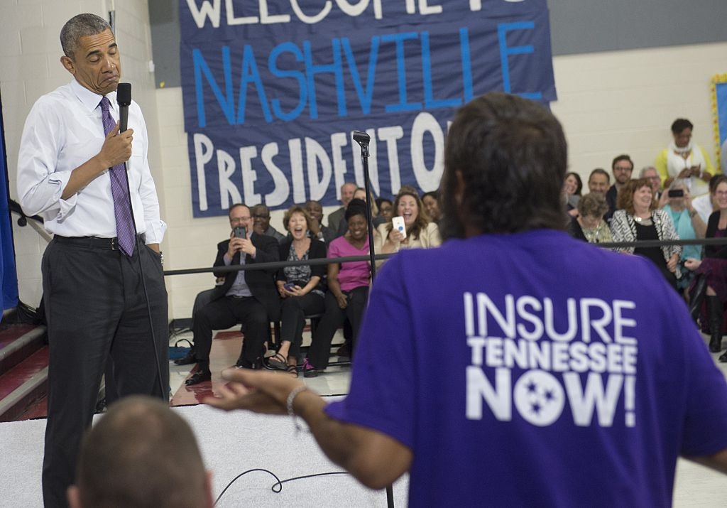 Then President Barack Obama reacts to a question from a man about the Affordable Care Act.
