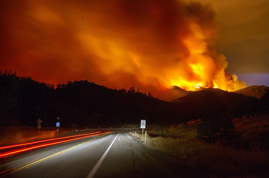 A forest fire burns in California