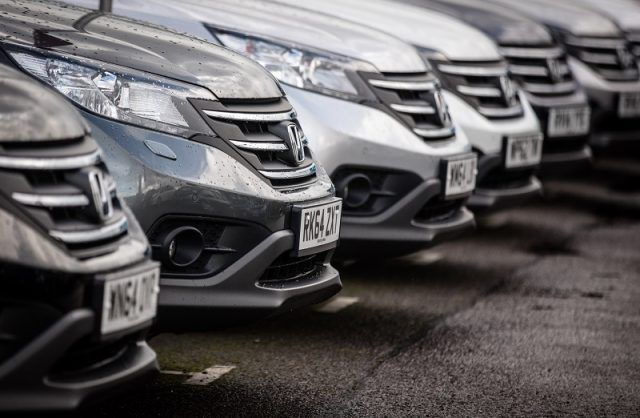 Honda cars are offered for sale on the forecourt of a main motor car center