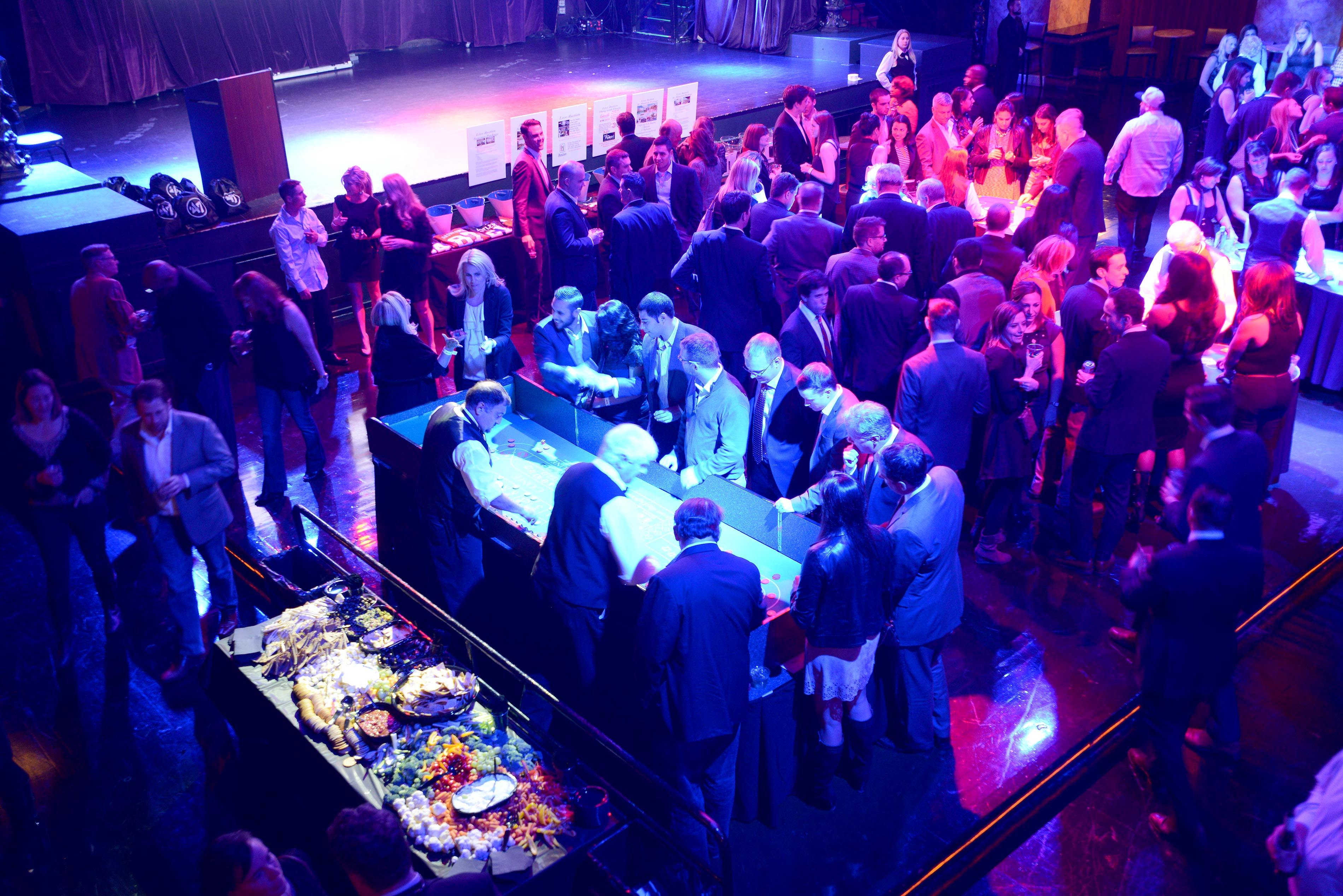 """People attend a casino night fundraiser to """"Tackle Sickle Cell"""" benefiting Boston Children's Hospital"""