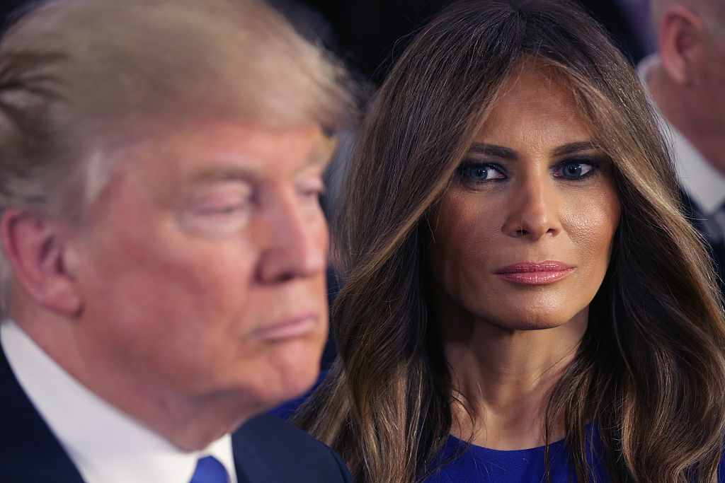 Trump and his wife Melania greet reporters
