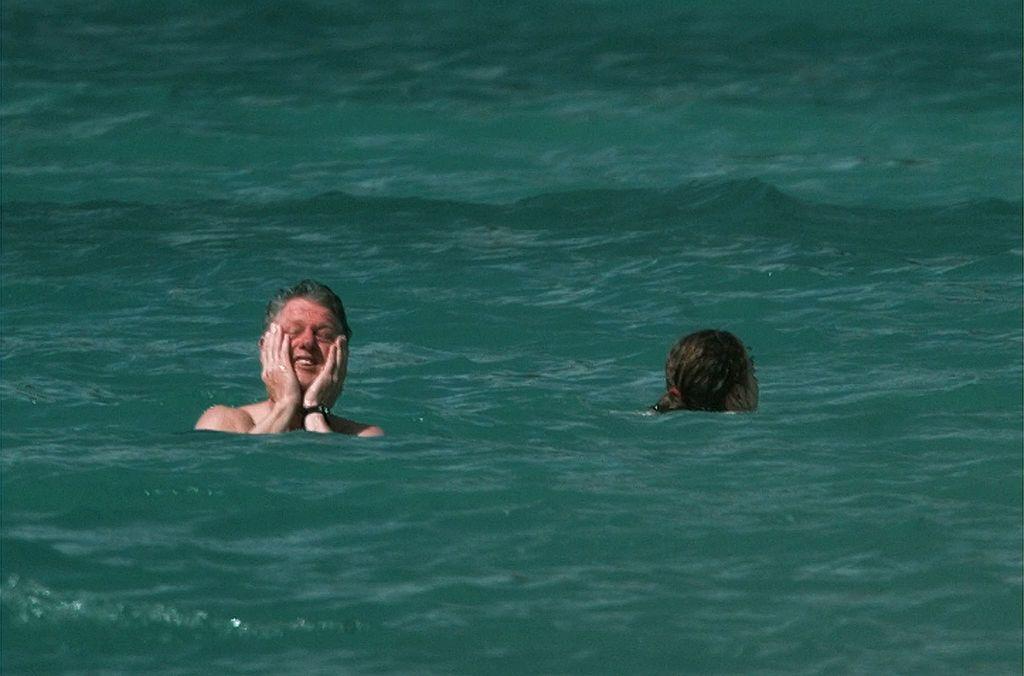 Bill Clinton and daughter Chelsea take a swim