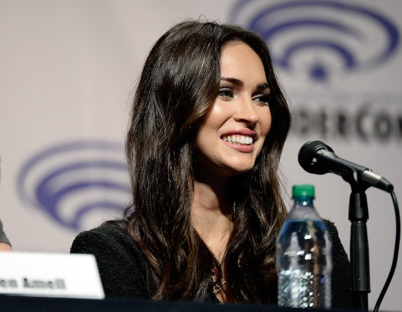 Actress Megan Fox sits behind a microphone while on a panel at WonderCon 2016
