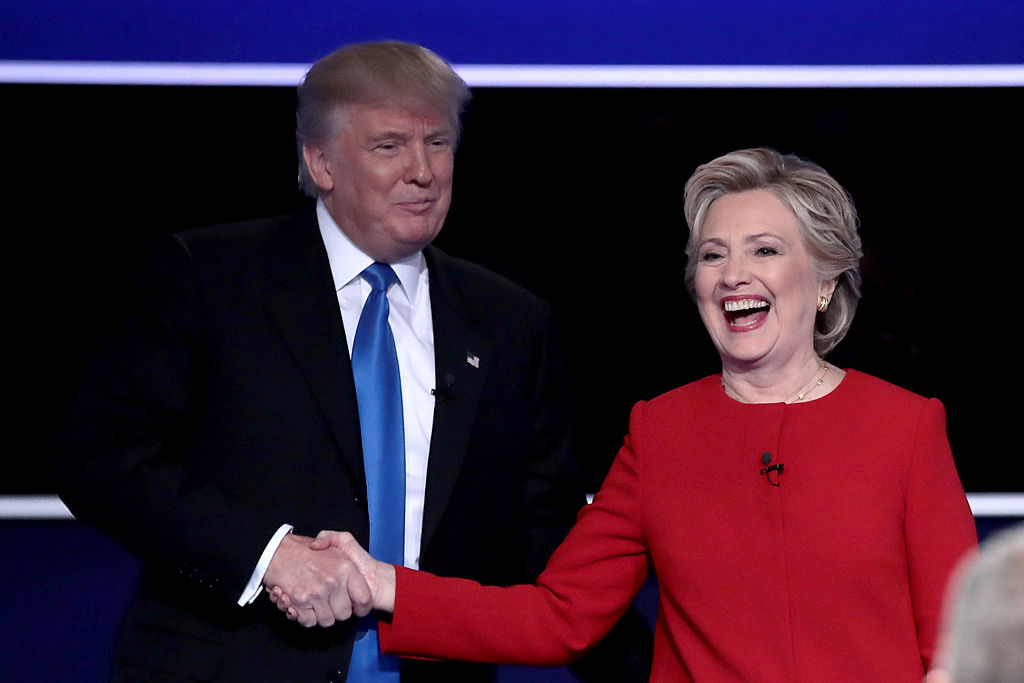 Trump shakes hands with Hillary Clinton