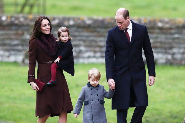 Kate Middleton, Prince William, and their children Charlotte and George walk together in winter clothing.