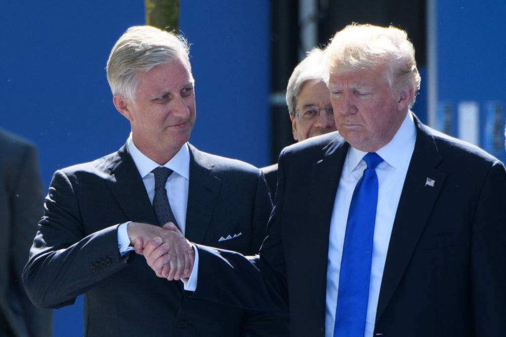 .Belgium's King Philip shakes hands with US President Donald Trump, seeing firsthand the president's affinity for power moves and strategic body language.