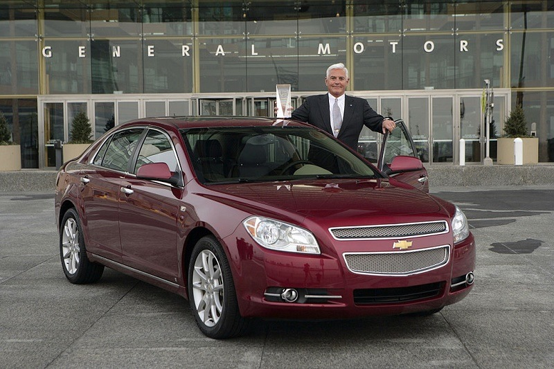 GM's Bob Lutz poses with Chevrolet Malibu, 2008 North American Car of the Year