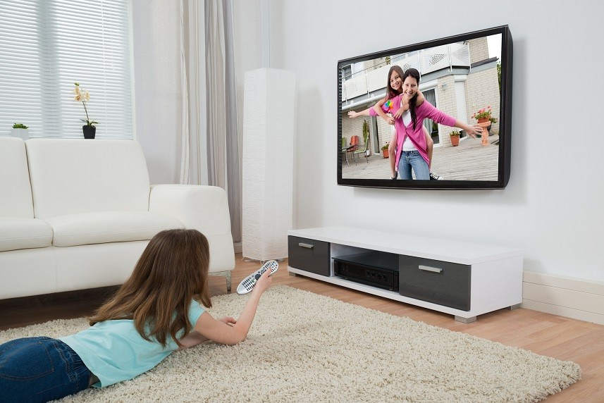 Girl With Remote Control Watching Movie
