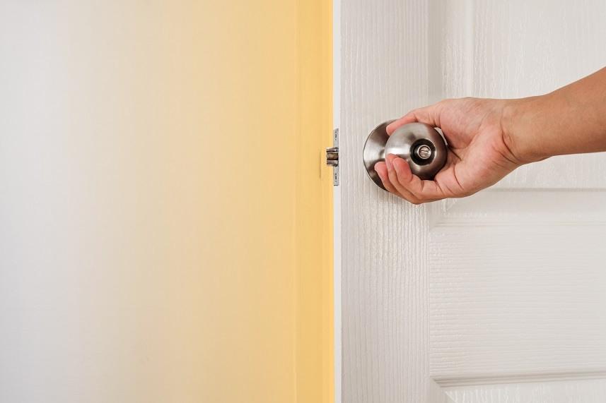Hand holding door knob