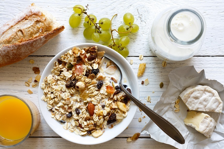 breakfast with muesli, grapes, cheese and juice