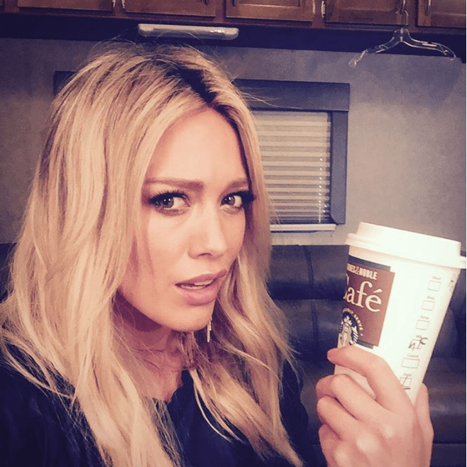 Hilary Duff with Starbucks cup