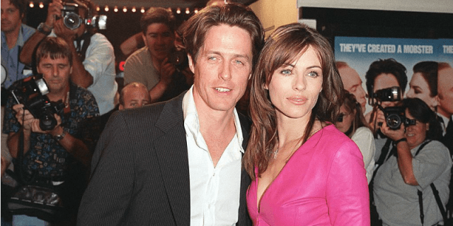 Hugh Grant and Elizabeth Hurley pose together on the red carpet.