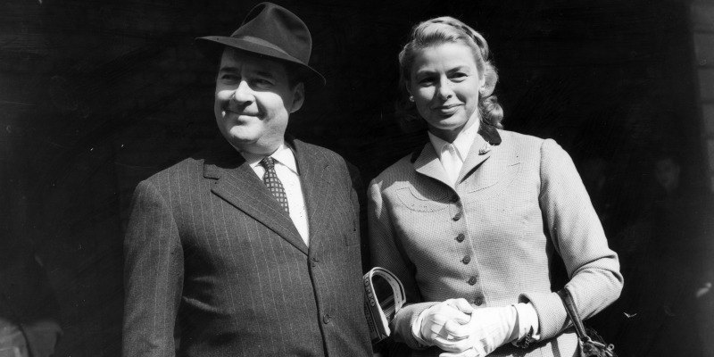 This is a black and white photo of Roberto Rossellini and Ingrid Bergman together.