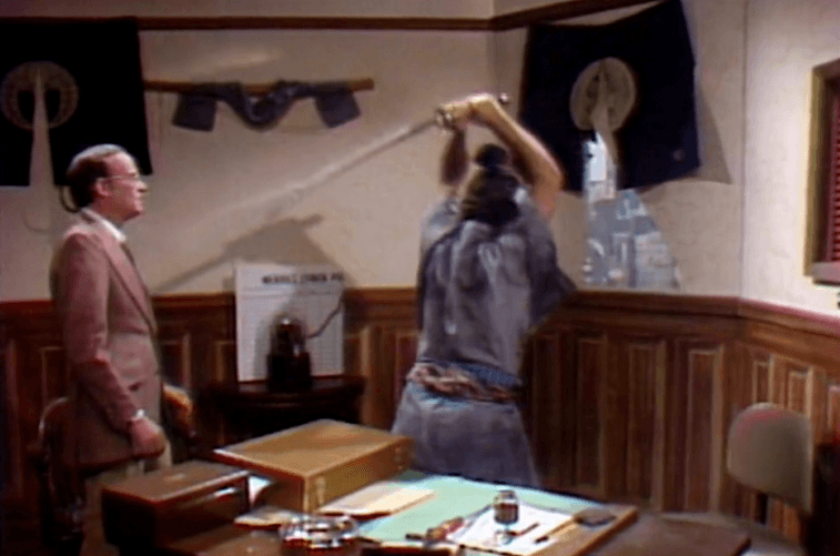 John Belushi uses a samurai sword on SNL as Buck Henry watches