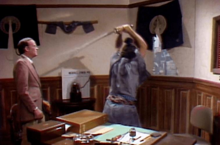John Belushi uses a samurai sword on SNL as Buck Henry watches