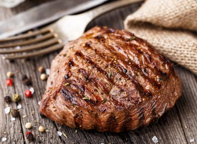 a grilled steak on a picnic table