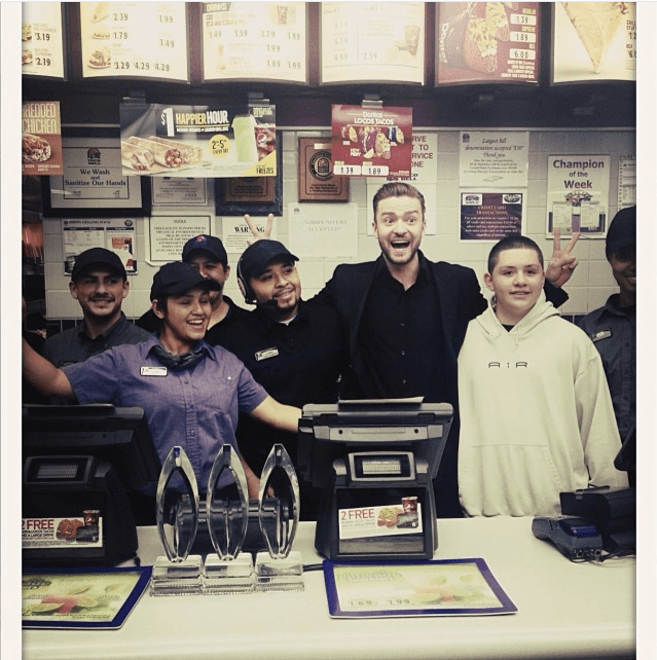 Justin Timberlake with staff at Taco Bell
