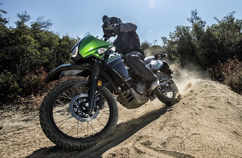 Lime green KLR 650 on a dirt path
