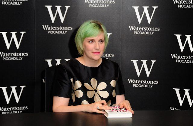 Lena Dunham poses for photos at her book signing.