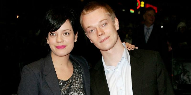 Lily Allen has her arm around Alfie Allen.
