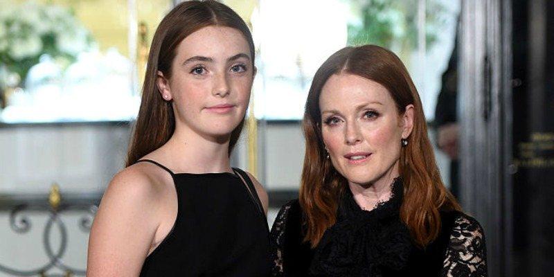 Liv Freundlich and Julianne Moore pose together in black dresses.