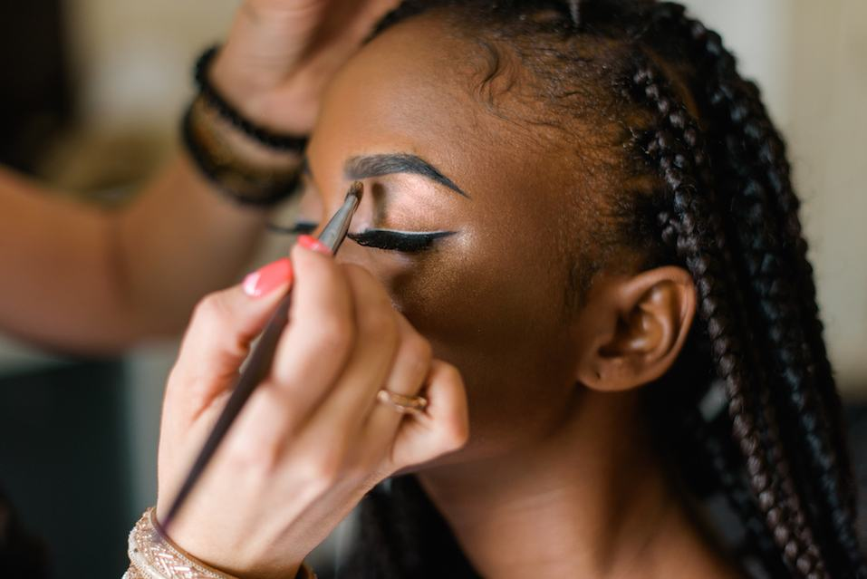 model getting made up for the runway