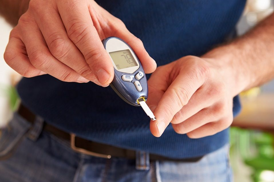 Male Diabetic Checking Blood Sugar