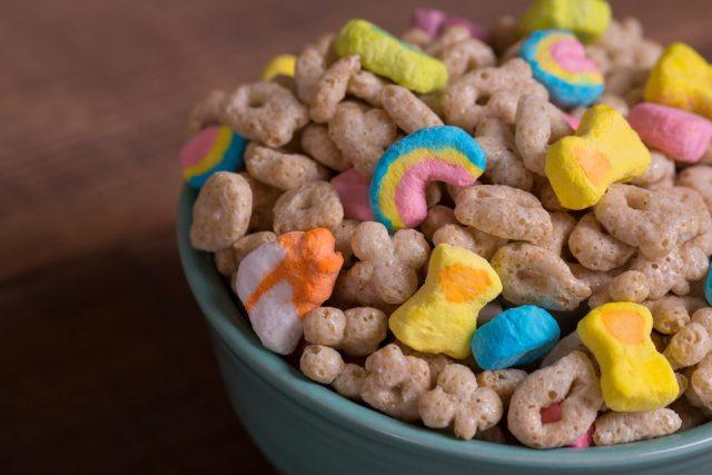 Sugary cereal in a blue bowl.