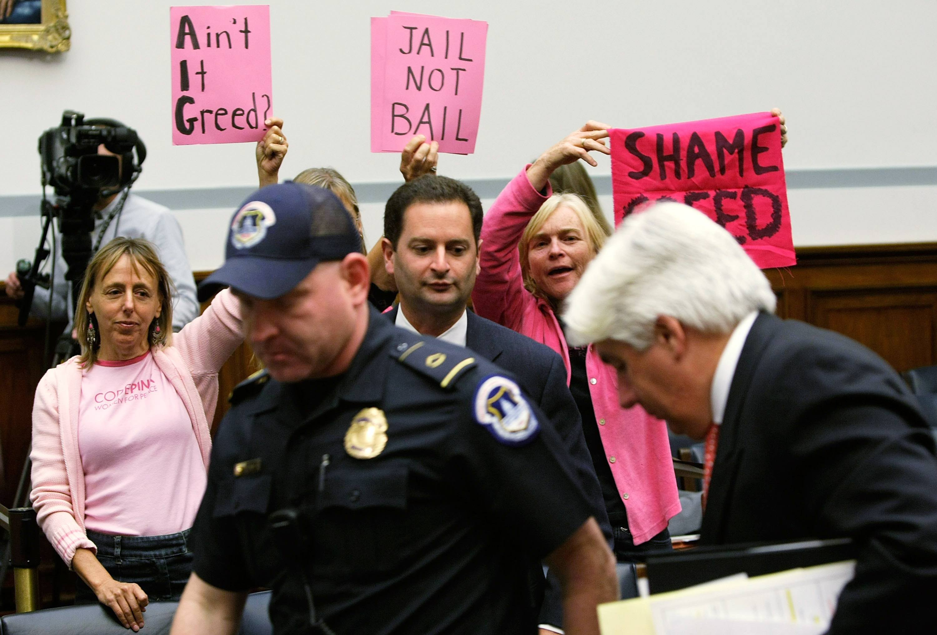 Members of Code Pink protest former AIG CEO Martin Sullivan.