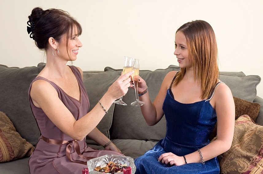 Mother and Teenage Daughter having a glass of wine
