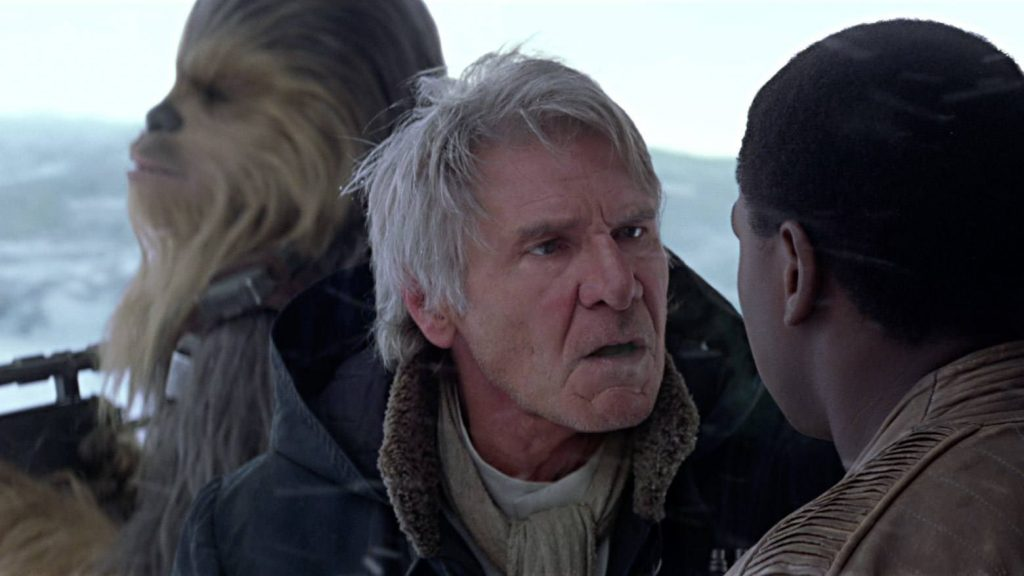 Han standing in front of Chewie, angrily lecturing Finn