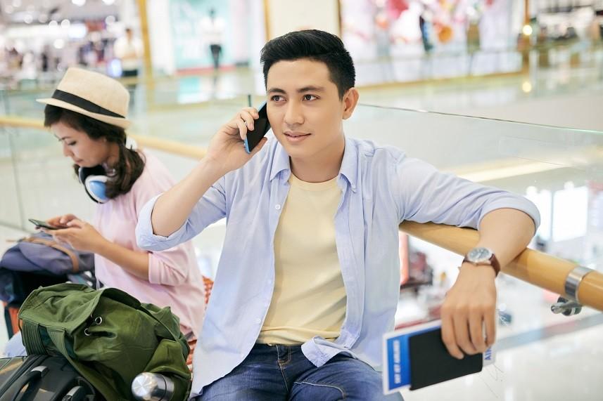 Vietnamese man sitting at airport