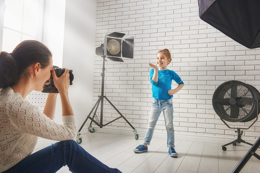 Young woman photographs her child
