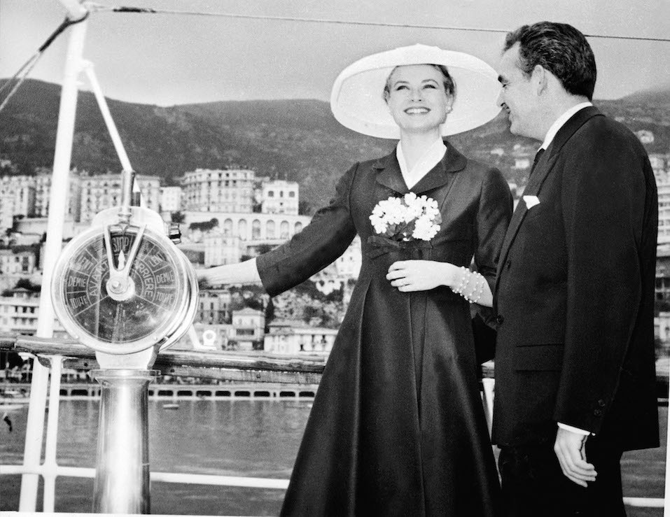 """Prince Rainier III of Monaco and Grace Kelly aboard the princely yacht """"Deo Juvante II"""" on April 12, 1956 in Montae Carlo's harbour."""