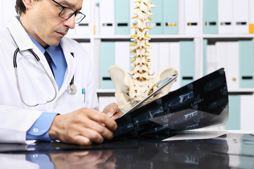 Radiologist checking x-ray