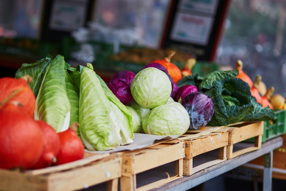 Ripe pumpkins and cabbage at a farmers market