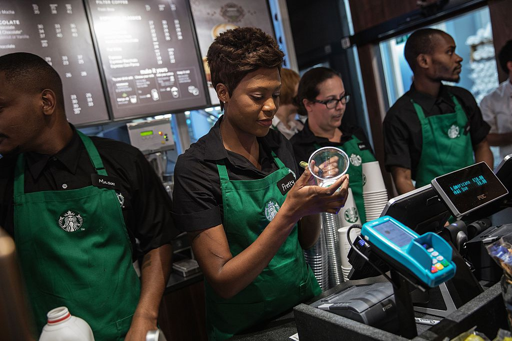 starbucks employees work behind the counter