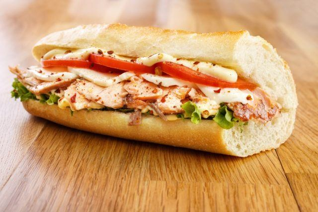 chicken sandwich with cheese and veggies