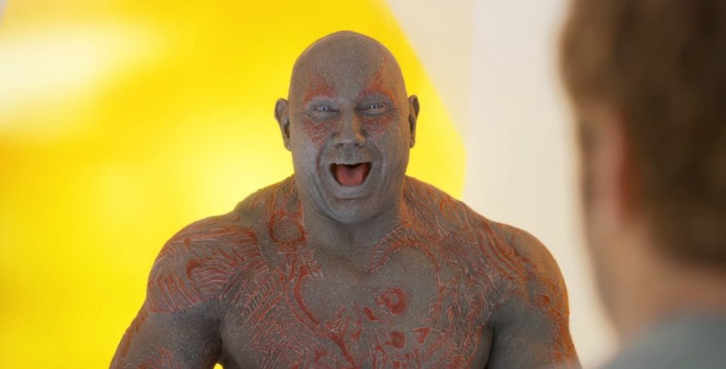 Drax smiling and laughing in a yellow room