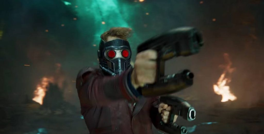 Star-Lord with his red-eyed helmet on, firing his gun