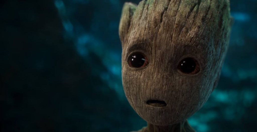 A close-up on Baby Groot, looking up bemusedly