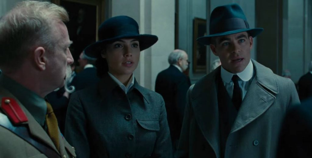 Wonder Woman and Steve Trevor wearing trenchcoats, having a conversation with two army officers