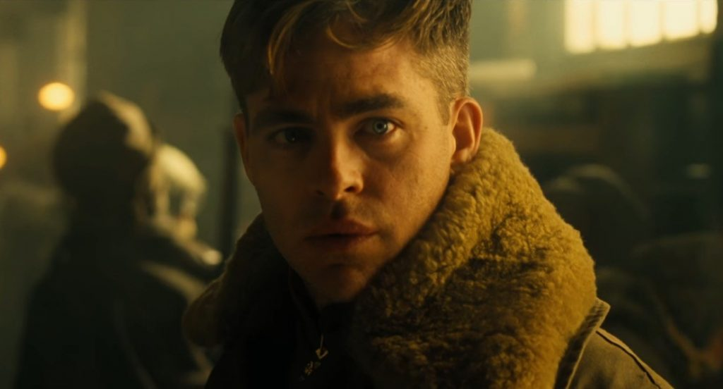 Steve Trevor in a fleece-lined jacket, looking at the camera