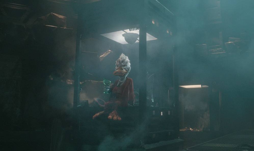 Howard the Duck, sitting on a ledge sipping a drink