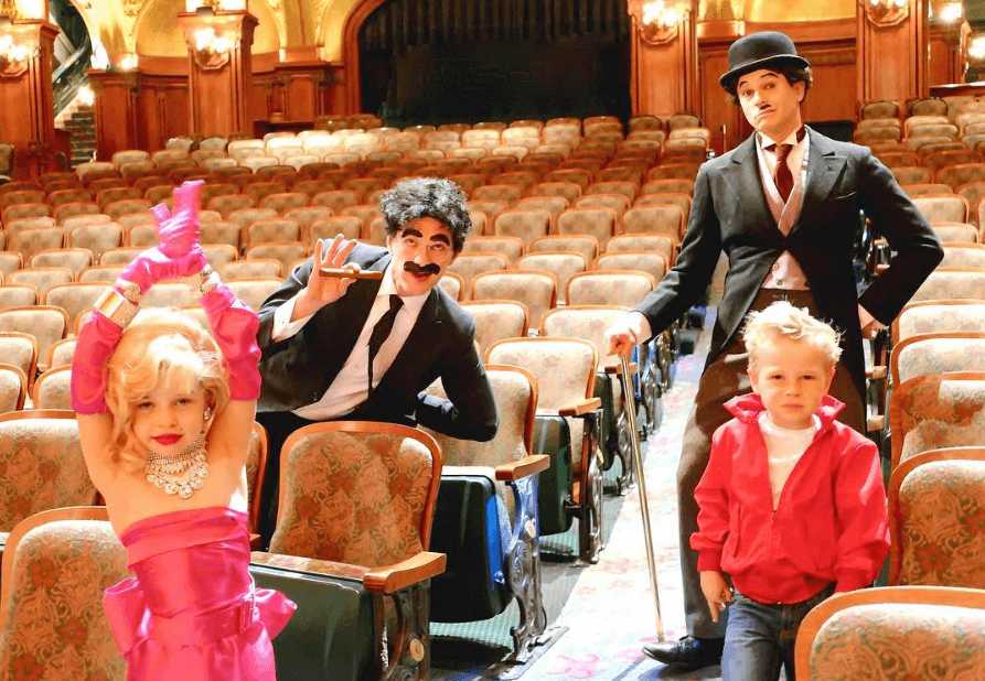 Neil Patrick Harris with husband David Burtka and twins Harper and Gideon pose in costumes