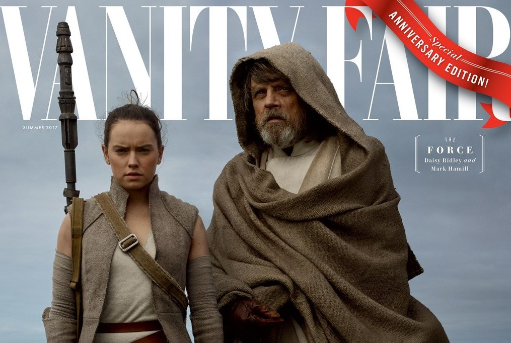 Rey and Luke, both wearing tan robes, standing against an overcast sky, on the cover of Vanity Fair