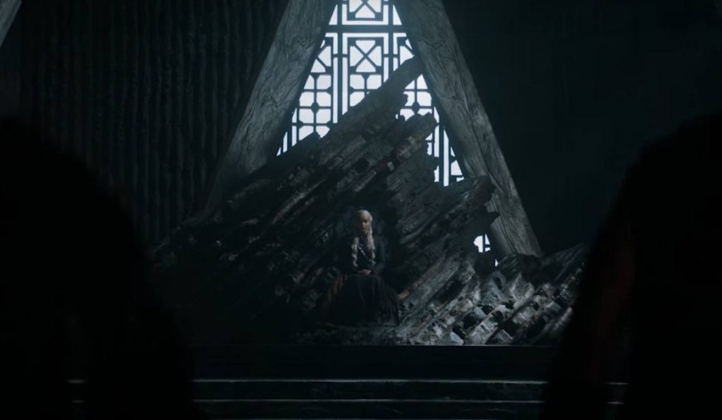 Daenerys sits on the windswept throne of Dragonstone in a darkened room