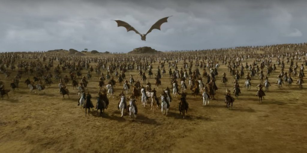 An army charges into battle, with a dragon flying above them